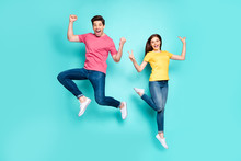 Full Length Body Size View Of Nice Attractive Funky Cheerful Cheery Crazy Couple Jumping In Air Having Fun Showing V-sign Isolated On Bright Vivid Shine Vibrant Green Turquoise Background