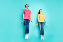 Full Length Body Size View Of Nice Attractive Lovely Cute Funky Cheerful Cheery Modest Couple Jumping In Air Having Fun Time Isolated On Bright Vivid Shine Vibrant Green Turquoise Background
