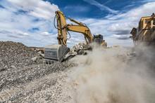 Excavator Moving Gravel In A Q...