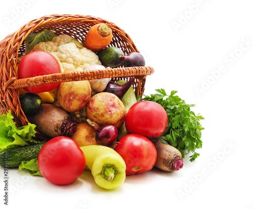 Vegetables spilled from the basket.