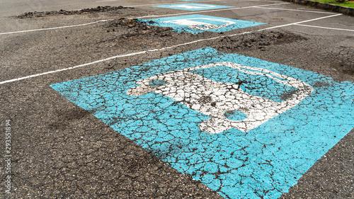 Fototapeta  Surface bumpy damaged concrete parking lot