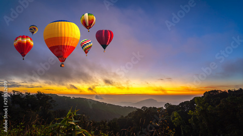 Poster Montgolfière / Dirigeable Colorful hot air balloons flying over Doi Inthanon National Park in sunrise time, Chiang Mai Province, Thailand.