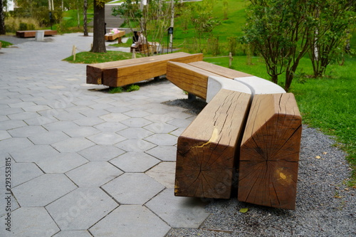 Obraz wooden bench with concrete in the park. Modern and classic together. - fototapety do salonu