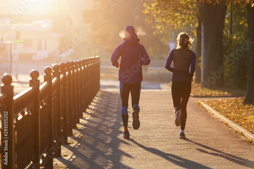 фотографія  Runners fitness couple running in the city park