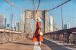 Leinwanddruck Bild - Young tourist on the Brooklyn Bridge
