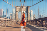 Fototapeta New York - Young tourist on the Brooklyn Bridge