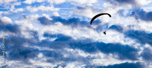 Photo silhouette of skydiver with parachute - live your dream, freedom and adrenaline