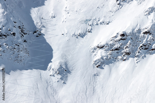 Fényképezés Back country skier climbing up through deep powder snow at the extremely steep s