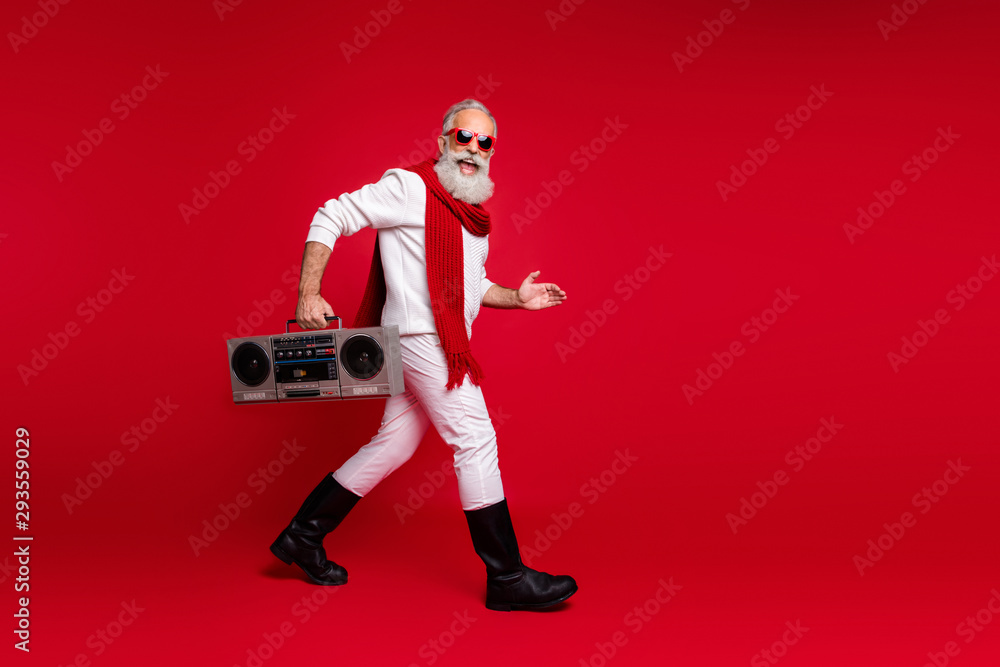 Fototapety, obrazy: Full body profile side photo of excited grandfather going holding audio cassette wearing white sweater isolated over red background