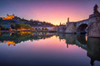 canvas print picture - Wurzburg, Germany. Cityscape image of Wurzburg with Old Main Bridge over Main river and Marienberg Fortress during beautiful autumn sunset.