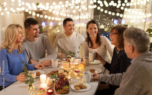 celebration, holidays and people concept - happy family having tea party at home Fototapeta