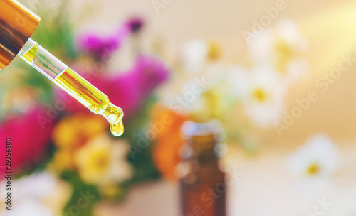 Homeopathy. Herbal extracts in small bottles. Selective focus.