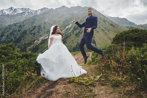 Fotografija Beautiful wedding photo on mountain lake