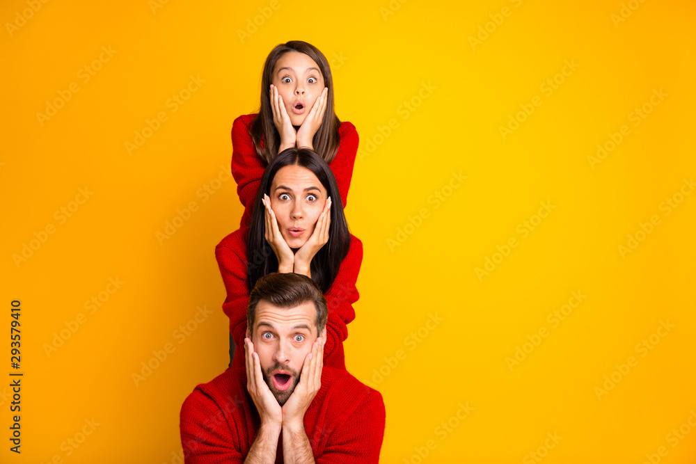 Fototapety, obrazy: Photo of excited crazy trendy cheerful cute funky positive family having built pyramid with their bodies astonished facial expression wearing red sweaters isolated over vivid color yellow background