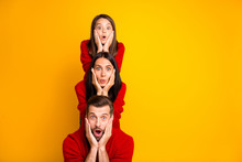 Photo Of Excited Crazy Trendy Cheerful Cute Funky Positive Family Having Built Pyramid With Their Bodies Astonished Facial Expression Wearing Red Sweaters Isolated Over Vivid Color Yellow Background