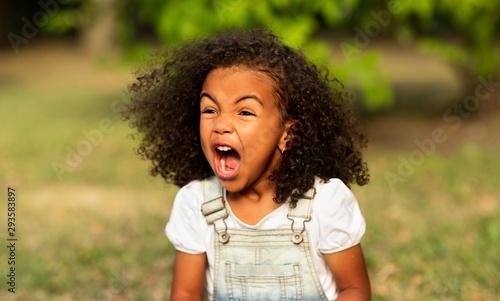 Fotografie, Obraz  Furious girl shouting over natural summer background
