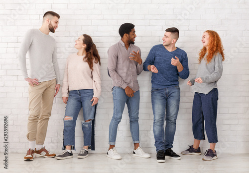 Fototapeta Young stylish friends talking, having break at college obraz