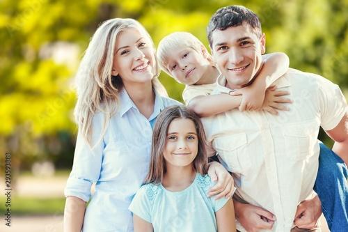 Obraz Beautiful smiling Lovely family in park - fototapety do salonu