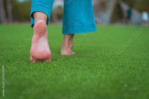 jeans barefoot walking on the grass Canvas Print