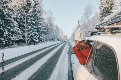 Obraz Magic car trip on the road by winter forest covered by snow - fototapety do salonu