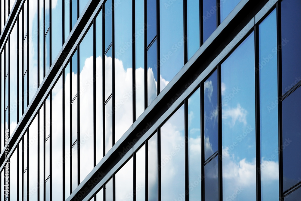 Fototapeta Glasfassade mit Wolkenspiegelung