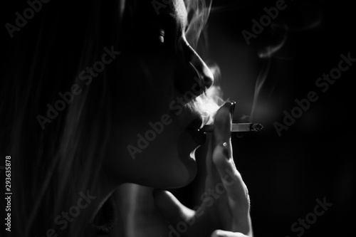 Fototapeta Artistic photo of a girl smoking cigarette,black and white,smoke obraz