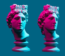 Statue Neon. On A Blue Isolated Background. Gypsum Statue Of Apollo's Head. Man.