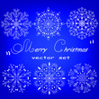 Set of white snowflakes on a blue background.White snowflakes collection on a colored background.