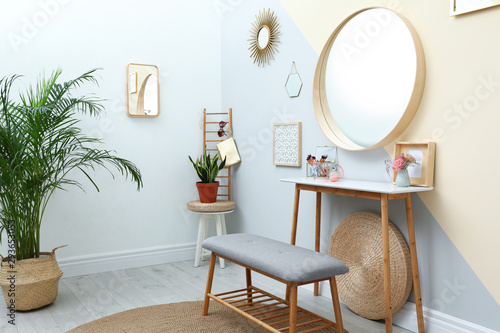 Stylish room interior with little table and comfortable bench Fototapet
