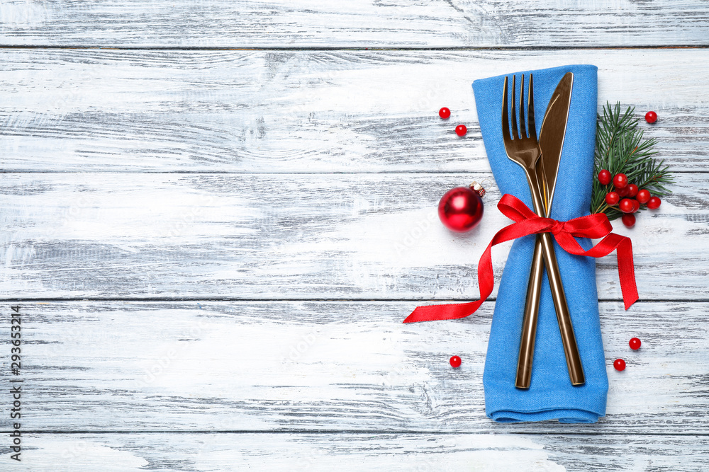 Fototapety, obrazy: Cutlery set on wooden table, top view with space for text. Christmas celebration