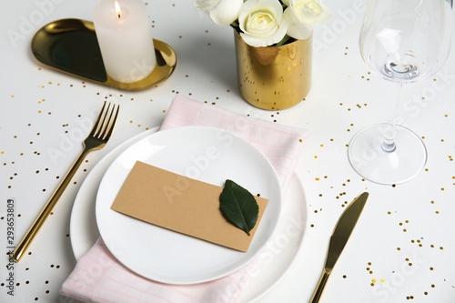 Elegant festive table setting with blank card on white background