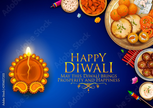 Photo  illustration of burning diya and Indian Sweet on Happy Diwali Hindu Holiday back
