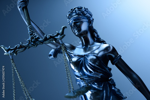 Statue of justice on blue background Wallpaper Mural