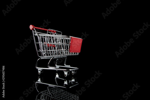 Fotografija Shopping cart empty, isolated on Black background with reflections