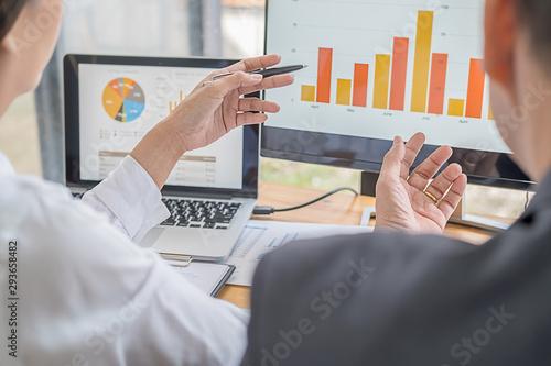 Vászonkép Business adviser analyzing financial figures denoting the progress Internal Revenue Service checking document