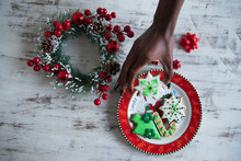 Hand Picking A Christmas Cookie