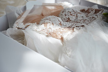 Beautiful Luxury Wedding Dress In White Box On Bed, Copy Space. Bridal Morning Preparations. Wedding Concept