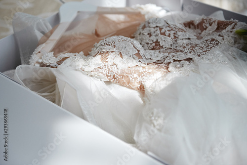 Leinwand Poster Beautiful luxury wedding dress in white box on bed, copy space