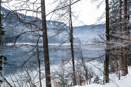 Fototapety, obrazy: Frozen lake and Alpine mountains. Winter lake and trees with snow. Beautiful landscape.