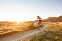 One Woman Enjoys The Warm Spring Weather Mountain Biking On The North Fruita Desert Trails Outside Of Grand Junction, Colorado.