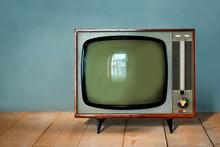 Vintage TV Set On Wooden Table...