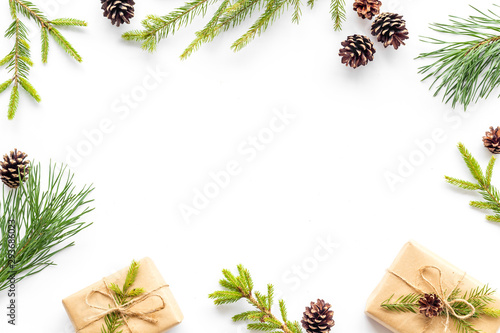 Photo  New Year frame with fir branches and present box mockup on white background top