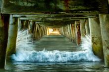 Waves Crashing Into The Posts Under The Historic Wharf At Tolaga Bay  Gisborne Region Of New Zealand
