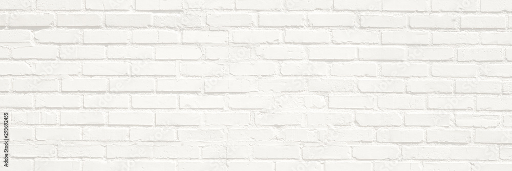 Fototapeta White brick wall background. Neutral texture of a flat brick wall close-up.