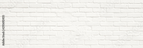 Poster Brick wall White brick wall background. Neutral texture of a flat brick wall close-up.