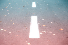 White Road Strip Marking On Asphalt. Background And Texture With Teal And Orange Color