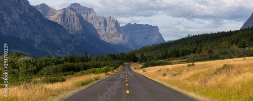 Fotografie, Obraz Beautiful Panoramic View of Scenic Highway with American Rocky Mountain Landscape in the background during a Cloudy Summer Morning