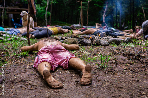 Obraz Diverse people enjoy spiritual gathering People seeking enlightenment and spiritual guidance are seen lying flat on sacred ground in a woodland clearing at a shamanic and multicultural retreat. - fototapety do salonu