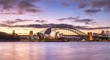 Sydney Harbour Skyline and Bridge panorama, NSW, Australia, Oceania, with dramatic colourful light at twilight sundown.