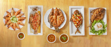 Variety Of Thai Style Seafood, Deep Fried Seabass And Butterfish With Spicy Sauce, Sweet And Sour Deep Fried Butterfish, Deep Fried Seabass In Chilli And Garlic Sauce And Baked King Prawn